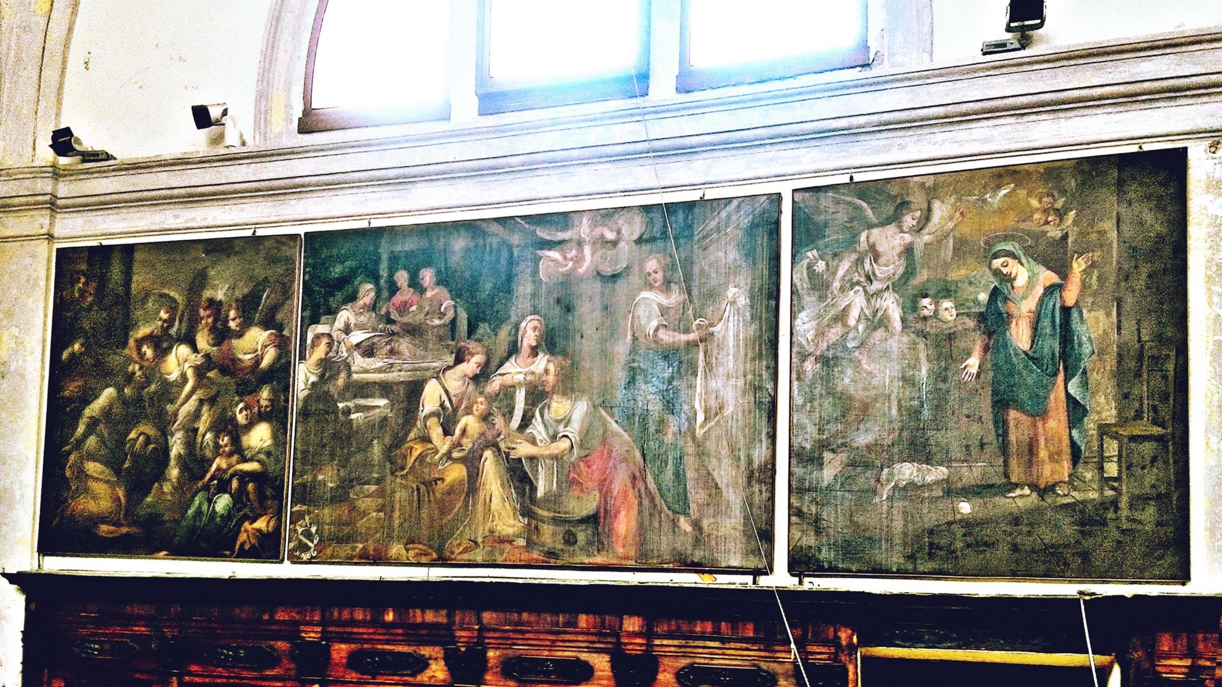 Vecchia chiesa di Battaglia Terme, le tre tele addossate alla parete meridionale del presbiterio.